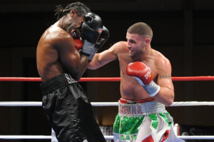Peter Manfredo Jr. landing a right to his opponent's chin   (all pictures courtesy of Emily Harney Photography / The Fight Source)